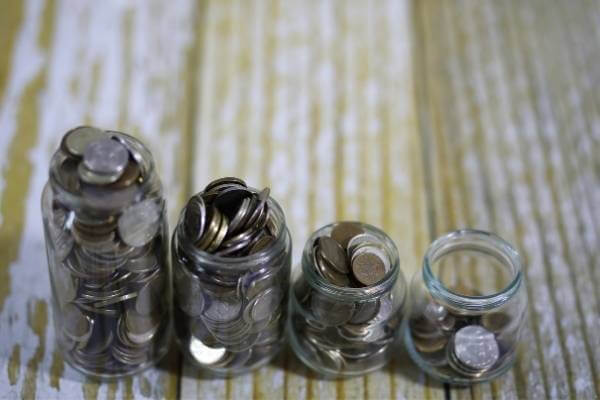 Jars of change representing fundraising